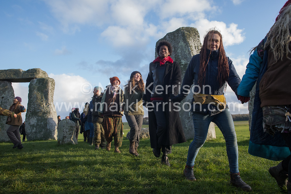 Around two hundred people, including local residents, climate and land justice activists and pagans, take part in a Mass Trespass at Stonehenge on 5 December 2020 in Salisbury, United Kingdom. The trespass was organised in protest against the approval by Transport Secretary Grant Shapps of a £1.7bn project for a two-mile tunnel beneath the World Heritage Site and a further eight miles of dual carriageway for the A303, as well as the government's £27bn Road Investment Strategy 2 (RIS2).