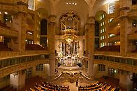 A choir performs a concert inside the Frauenkirche (church), Dresden, Saxony, Germany