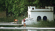 .Barcelona Olympic Games 1992.Olympic Regatta - Lake Banyoles.Spainish cox carries blades out onto pontoon with Castillian buidling in the background..       {Mandatory Credit: © Peter Spurrier/Intersport Images]..........       {Mandatory Credit: © Peter Spurrier/Intersport Images]......... Rowing Course: Lake Banyoles