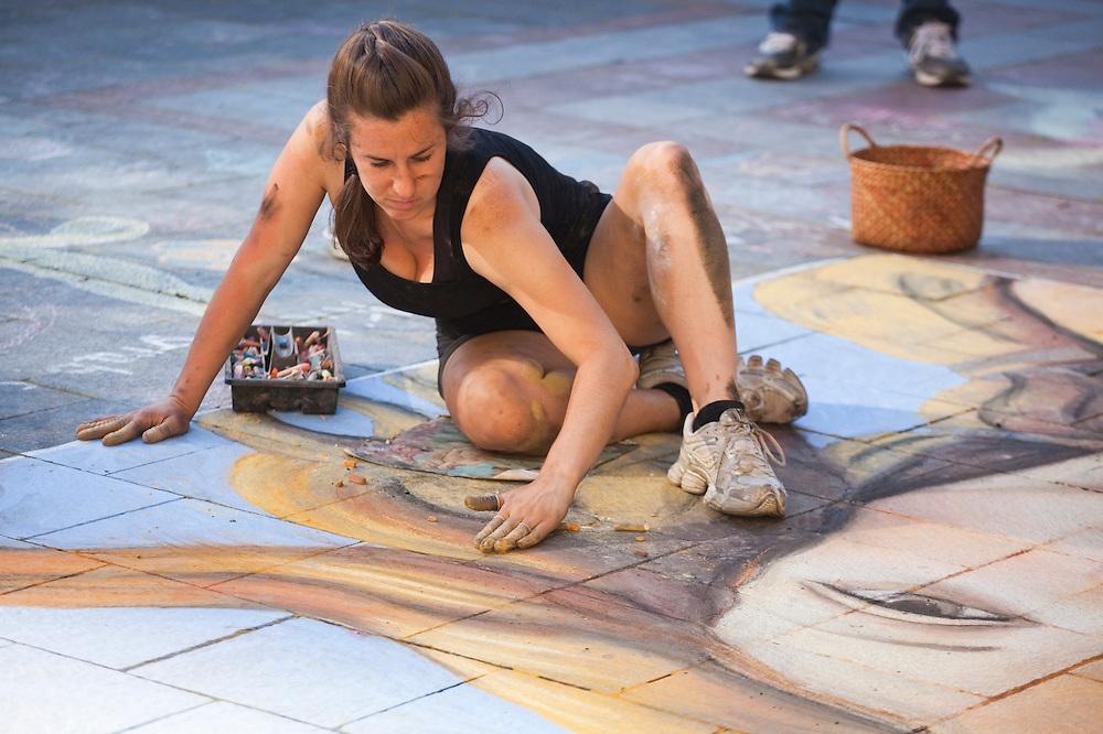 Chalk artist Gabrielle Abbott paints Botticelli's Venus with pastels on the Westlake Center Plaza in Seattle, Washington.