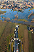 Nederland, Limburg, Roermond, 2011-01-10; Roerdal met riviertje de Roer, ten zuiden van Roermond. Door het hoogwater zijn landerijen onder water te komen staan. Boven in beeld de ingang van de Roertunnel..Valley of River Roer, south of Roermond. Because of the high water the land is submerged. High water due to snow melt and precipitation upstream. .Notice entrance tunnel..luchtfoto (toeslag), aerial photo (additional fee required).foto/photo Siebe Swart