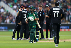 Pakistan's Imam-ul-Haq walks off after bowled by Lockie Ferguson and caught by Martin Guptill during the ICC Cricket World Cup group stage match at Edgbaston, Birmingham.