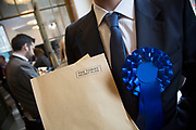 London, UK. Wednesday 29th April 2015. Labour Party member and supporter with a fake Tory dossier at a General Election 2015 campaign event on the Tory threat to family finances, entitled: The Tories' Secret Plan. Held at the Royal Institute of British Architects.