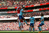 Laurent Koscielny of Arsenal wins a header from Tyrone Mings of Bournemouth . Premier league match, Arsenal v AFC Bournemouth at the Emirates Stadium in London on Saturday 9th September 2017. pic by Kieran Clarke, Andrew Orchard sports photography.