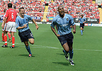 Nicolas Anelka (Man City) celebrates scoring goal no.1 from the penalty spot with Joey Barton (left). Charlton Athletic v Manchester City. 17/8/2003. Credit : Colorsport.