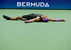 September 8, 2019, Flushing Meadow, NY, USA: FLUSHING MEADOW, NY - SEPTEMBER 08: Rafael Nadal (ESP) falls to  the court after winning the men's singles title of the US Open on September 8, 2019, at the Billie Jean King Tennis Center in Flushing Meadow, NY. (Photo by Cynthia Lum/Icon Sportswire) (Credit Image: © Cynthia Lum/Icon SMI via ZUMA Press)