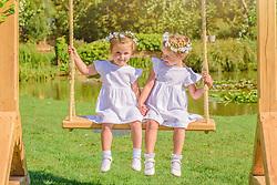 Two bridesmaids having fun on the wedding swing