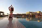 Jordan, Aqaba, Tala Bay Luxury Beach Resort Yoga by the swimming pool