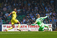 Burton Albion forward Lucas Akins (10) has shot at goal saved by Southend United goalkeeper Mark Oxley (1)  during the EFL Sky Bet League 1 match between Southend United and Burton Albion at Roots Hall, Southend, England on 22 April 2019.