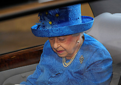 Queen Elizabeth II arrives for the State Opening of Parliament in the House of Lords at the Palace of Westminster in London.