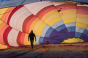 A hot air balloon pilot inspects the inside of the balloon before inflation in San Miguel de Allende, Mexico.