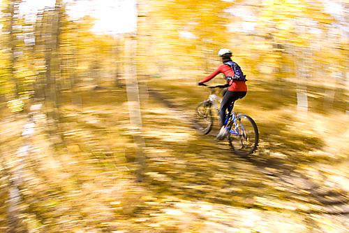 Young woman mountain biking near South Lake Tahoe, CA.