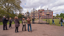 © Licensed to London News Pictures. 03/05/2015. London, UK. Well-wishers and tourists gather outside Kensington Palace to show support for the new daughter of the Duke and Duchess of Cambridge who was born the previous day. Photo credit : Stephen Chung/LNP