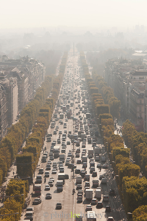 The boulevard of Champs Elysees, the famous street in Paris, France seen from the Arc de Triomphe