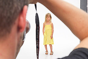 Young female child during a photoshoot for a fashion company