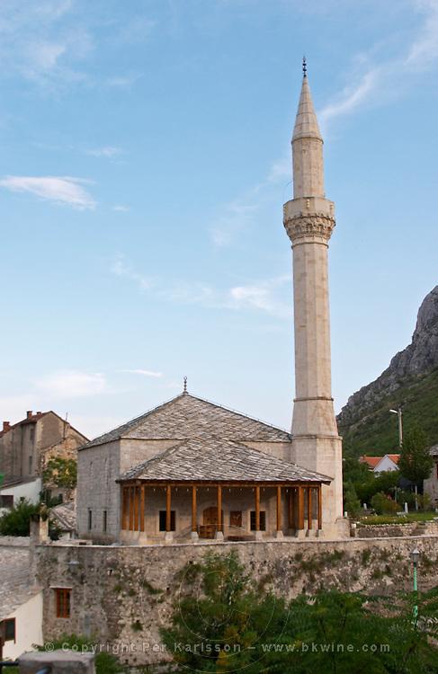 Modern looking mosque in the Jusovina street near riva Cuprija bridge. Historic town of Mostar. Federation Bosne i Hercegovine. Bosnia Herzegovina, Europe.