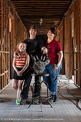 Anne, Dylan and Paul Cox in Anne's R.H. Smith Mercantile building. Port Jervis, NY. USA. Monday June 11, 2018. Photography ©2018 Michael Lichter.