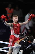 Commonwealth Games, Glasgow 2014<br /> Boxing Finals<br /> Charlie Flynn wins Gold for Scotland in the Hydro<br /> <br /> Men's Lightweight Final<br /> Charlie Flynn of Scotland v Joe Fitzpartick of NIR<br /> <br /> Charlie Flynn had his medal presented by boxing legend Dick McTaggart<br /> <br />  Neil Hanna Photography<br /> www.neilhannaphotography.co.uk<br /> 07702 246823