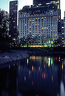 Plaza Hotel reflected in the Pond Central Park, New York City, NY,  Hotel designed by Henry J Hardenbergh, Central Park designed by Frederick Law Olmsted and Calvert Vaux, Pond, Winter