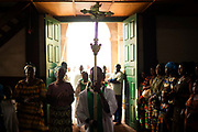 A boy carries a cross at the beginning of Sunday mass in a church in Wango, a district of the capital Bangui January 26, 2014.