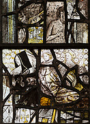 Medieval stained glass window, Holy Trinity church, Long Melford, Suffolk, England fragments with faces and figures