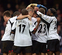 Photo. Javier Garcia<br />08/02/2003 Fulham v Aston Villa, FA Barclaycard Premiership, Loftus Road<br />Jon Harley's face peeps through as he is mobbed after his winning goal