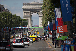 The peloton starts the first lap of the La Course, a 89 km road race in Paris on July 24, 2016 in France.