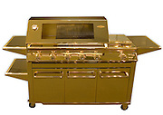 The bling barbecue: World's most expensive grill is plated all over in 24-carat gold... and it's yours for $165,000<br /> <br /> If your barbecue is beginning to rust away and wasn't quite up to the job on Memorial Day weekend, then why not replace it with this one?<br /> The world's most expensive barbecue - all individually plated in 24-carat gold and built by hand - is yours for around $165,000.<br /> Australian firm BeefEater Barbecues produces the 'ultimate in backyard bling' - a grill completely plated in gold apart from the cooking surfaces.<br /> The grill was first built for the Sydney Home Show and was later verified as the world's most expensive barbecue in November 2009.<br /> The company was celebrating being named the World's Finest Barbecue in a global review of the world's finest luxury products.<br /> It is a pimped-out version of the firm's Signature Series 6 Burner SL4000 and became the world's first fully-functional gold barbecue.<br /> <br /> It boasts a six-burner barbecue and wok burner, quartz start ignition, warming rack, roasting hood, high-output burners and vaporiser grid.<br /> The company said it made the golden grill for those who 'want to make a statement with their barbecue and have the money to burn'.<br /> 'Part of the fun of having a barbecue is putting on a show, and that's what we do best,' a BeefEater Barbecues spokesman said.<br /> He added that it was only made to see how much in 'opulence, price and features' the company could fit into one product.<br /> With the gold price currently above $1,500 per ounce it could also represent a decent investment if the price continues to rise.<br /> ©Exclusivepix