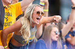 Oct 2, 2021; Morgantown, West Virginia, USA; A West Virginia Mountaineers fan cheers during the second quarter against the Texas Tech Red Raiders at Mountaineer Field at Milan Puskar Stadium. Mandatory Credit: Ben Queen-USA TODAY Sports