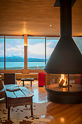 Hotel interior with chimney and window with view, Tierra Patagonia Hotel, Torres del Paine National Park, Chile