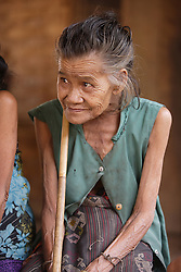 Nang So 85 years old is the oldest lady in the group. She walsk with a stick now, but is still mobile and living with her extended family. People gather for an Older People's Group meeting where they will discuss individual and group needs.  <br /> Had Yen Village, Pakseng District, Luang Prabang Province, Lao PDR