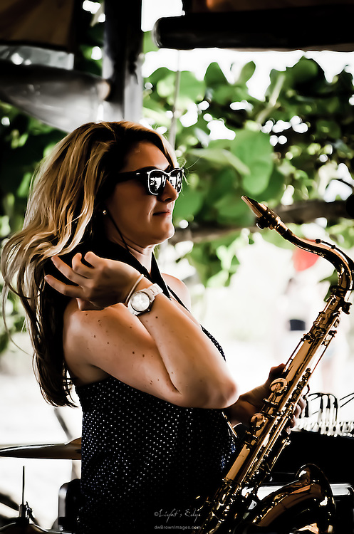 Mikayla Winner, lead vocals and sax for the group Anchor Atlantic, while performing at The Postcard Inn's beach bar in St. Pete Beach, Florida.