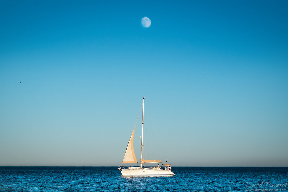 Sail-boat under the rising morning in Marbella coast.<br /> Thanks for your visit.