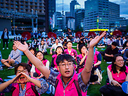 "15 JUNE 2018 - SEOUL, SOUTH KOREA:  South Koreans cheer during a rally to mark the anniversary of the signing of the June 15th North–South Joint Declaration between South Korea and North Korea. The Declaration was negotiated by late South Korean President Kim Dae-jung and North Korean leader Kim Jong-il and signed on 15 June 2000. It was a part of South Korea's ""Sunshine Policy,"" which guides the South's relationship with North Korea. This year's observance of the anniversary was bolstered by the recent thawing in relations between North Korea and South Korea and the US.    PHOTO BY JACK KURTZ"