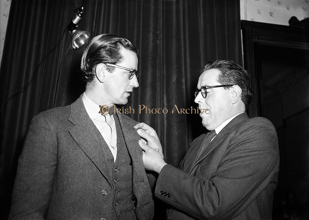 Dr Noel Browne TD Receives a Fainne at Belvedere Hotel.14/11/1953..Noël Christopher Browne (20/12/1915 - 21/05/1997) was an Irish politician and doctor. He holds the distinction of being one of only five Teachtaí Dála (TDs) to be appointed Minister on their first day in the Dáil. His controversial Mother and Child Scheme in effect brought down the First Inter-Party Government of John A. Costello in 1951..Browne was a well-known but at times highly controversial public representative and managed to be a TD for five different political parties (two of which he co-founded). These were Clann na Poblachta (resigned), Fianna Fáil (expelled), National Progressive Democrats (co-founder), Labour Party (resigned) and the Socialist Labour Party (co-founder)..