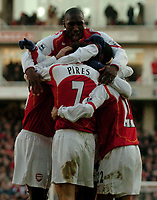 Fotball<br /> Premier League England 2004/2005<br /> Foto: SBI/Digitalsport<br /> NORWAY ONLY<br /> <br /> Arsenal v Fulham<br /> Barclays Premiership. 26/12/2004.<br /> <br /> Arsenal's Sol Campbell (Top) joins the celebrations after Robert Pires (#7) scores his side's second goal.