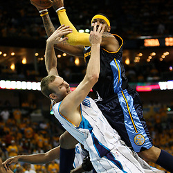 25 April 2009: Denver Nuggets forward Carmelo Anthony (15) collides with New Orleans Hornets forward Sean Marks (4) on a shot attempt during a 95-93 win by the New Orleans Hornets over the Denver Nuggets in game three of the NBA Western Conference quarter-finals playoff at the New Orleans Arena in New Orleans, Louisiana.
