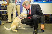 28 AUGUST 2012 - PHOENIX, AZ:  Rep. DAVID SCHWEIKERT (R-AZ) and his dog, CHARLIE, at Schweikert's campaign victory party Tuesday night. Schweikert faced Congressman Ben Quayle in what was the hardest Republican primary election in Arizona in 2012. Both were incumbent Republican freshmen elected to Congress from neighboring districts in 2010. They ended up in the same district at the end of the redistricting process and faced off against each other in the primary to represent Arizona's 6th Congressional District, which is made up of Scottsdale, Paradise Valley and parts of Phoenix. The district is solidly Republican and the winner of the primary is widely expected to win November's general election. Both are conservative Republicans with Tea Party backing.   PHOTO BY JACK KURTZ