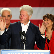 Former President Bill Clinton (center) speaks as Florida Democratic gubernatorial candidate Charlie Crist and running mate Annette Taddeo listen, at a campaign event on Monday, Nov. 3, 2014, at the UCF Arena in Orlando, Fla. Crist, a former Florida Republican governor, is running against Republican Florida Gov. Rick Scott.  (AP Photo/Alex Menendez)