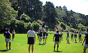 Fafili Levave goes up for a lineout as coach mark Hammett (2nd left) looks on. Super 15 rugby union Hurricanes training at Rugby League Park, Wellington, New Zealand on Thursday 27 January 2011. Photo: Dave Lintott / photosport.co.nz