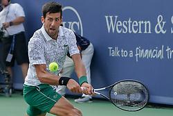 August 19, 2018 - Mason, Ohio, USA - Novak Djokovic (SRB) hits a backhand shot during Sunday's final round of the Western and Southern Open at the Lindner Family Tennis Center, Mason, Oh. (Credit Image: © Scott Stuart via ZUMA Wire)