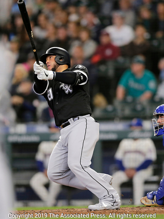 Chicago White Sox's Welington Castillo hits a grand slam on a pitch from Seattle Mariners' Brandon Brennan during the fifth inning of a baseball game, Sunday, Sept. 15, 2019, in Seattle. (AP Photo/John Froschauer)