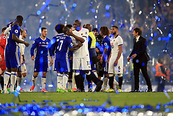 15 May 2017 - Premier League - Chelsea v Watford - Watford and Chelsea players shake hands under a shower of streamers and ticker tape - Photo: Marc Atkins / Offside.