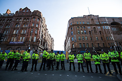 © Licensed to London News Pictures . 04/10/2015 . Manchester , UK .  Police surround the Midland Hotel as scuffles break out . A demonstration against the Conservative government , organised by The People's Assembly , at Castlefield Bowl in Manchester , during the first day of the Conservative Party Conference in Manchester . Photo credit: Joel Goodman/LNP