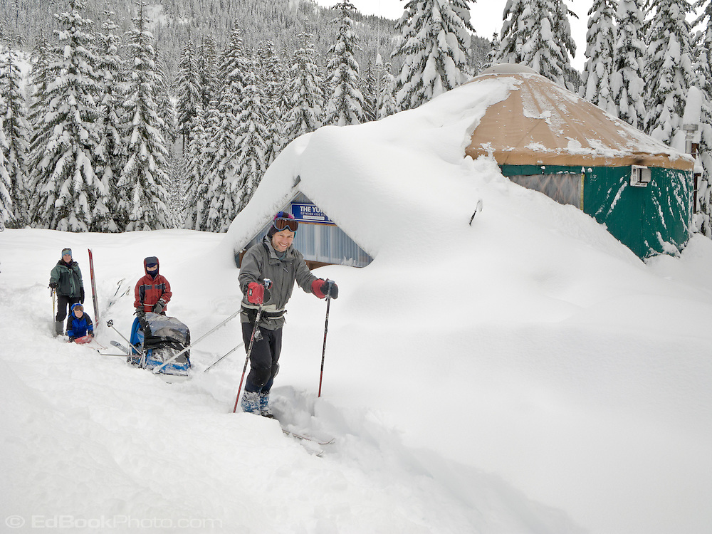 A happy family getting ready for their ski out from the Mount Tahoma Trails Yurt maintained by the Mount Tahoma Trails Association based in Ashford, Washington near the SW entrance to Mount Rainier National Park.