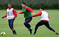 Photo: Javier Garcia/Back Page Images Mobile +447887 794393<br />Arsenal FC UEFA Champions League Training, London Colney, 06/12/04<br />Robin Van Persie skips past Ashley Cole, left, and Jose Antonio Reyes, right