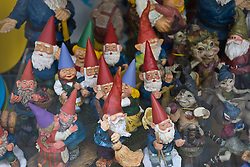 collection of elves and figurines photographed in a store window
