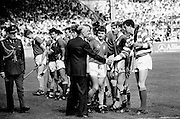 In the senior hurling final, Cork emerged victorious over a much-fancied Galway team, with a score of 4-13 to Galway's 2-15. The team are introduced to President Dr Patrick Hillery by Cork captain Liam Cashman.<br /> 7 September 1986