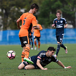 BRISBANE, AUSTRALIA - NOVEMBER 12: Christian Theoharous of the Victory tackles Cameron Crestani of the Roar during the round 1 Foxtel National Youth League match between the Brisbane Roar and Melbourne Victory at Spencer Park on November 12, 2016 in Brisbane, Australia. (Photo by Patrick Kearney/Brisbane Roar)