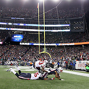 FOXBOROUGH, MASSACHUSETTS - JANUARY 14:  Running back James White #28 of the New England Patriots scores a touchdown while challenged by inside linebacker Benardrick McKinney #55 of the Houston Texans and strong safety Corey Moore #43 of the Houston Texans during the Houston Texans Vs New England Patriots Divisional round game during the NFL play-offs on January 14th, 2017 at Gillette Stadium, Foxborough, Massachusetts. (Photo by Tim Clayton/Corbis via Getty Images)